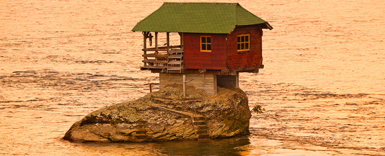 Openground House on rock island in river